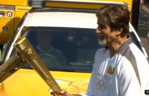 Amitabh Bachchan carries olympic flame