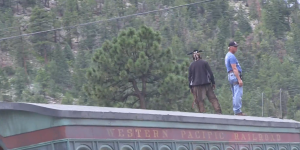 Western Pacific Railroad Train car with Johnny Depp dressed as Tonto and New Mexico in Background